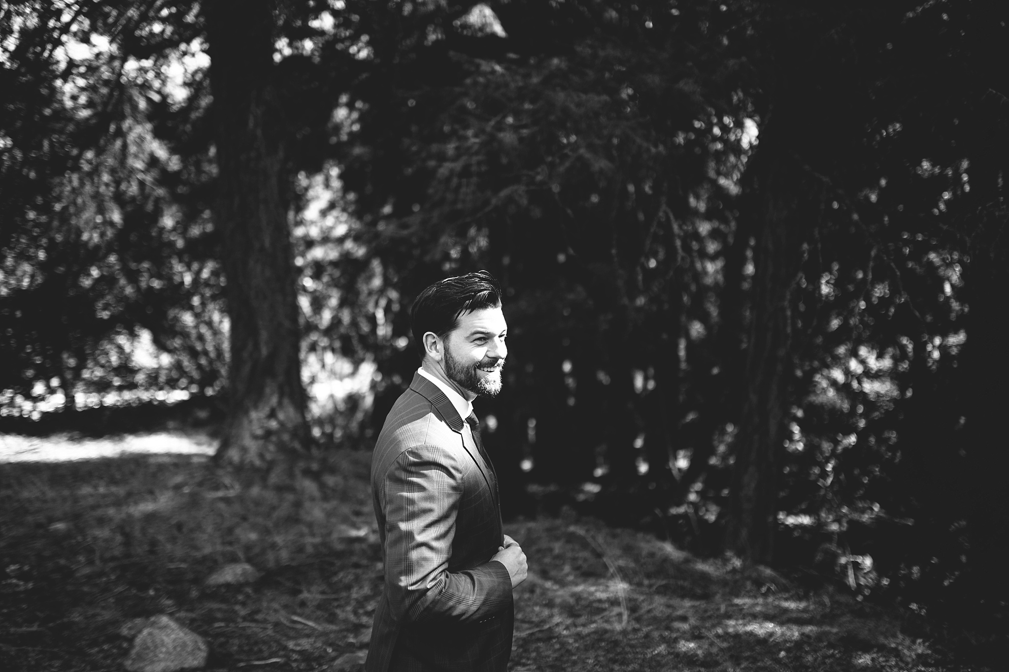 groom ready for first look in the woods