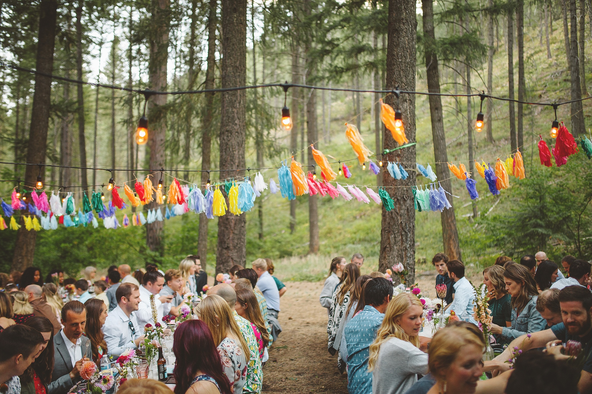 colorful outdoor wedding reception in woods
