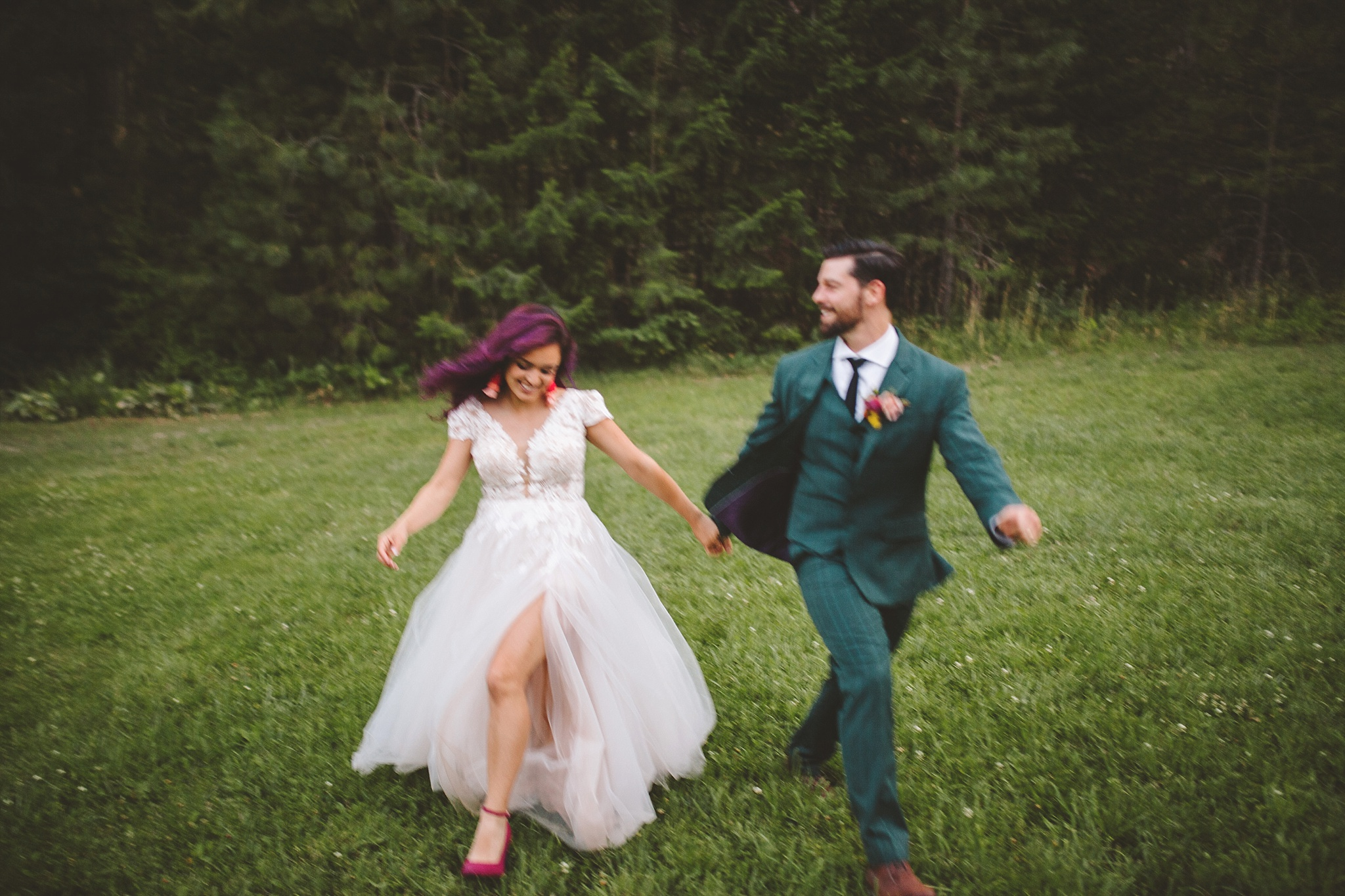 bride and groom in the woods of washington