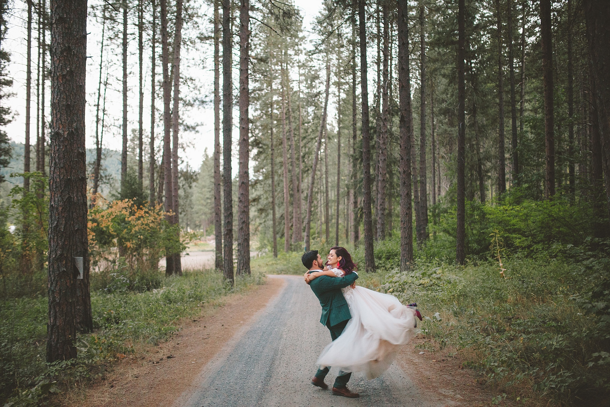 couple dances in woods for wedding