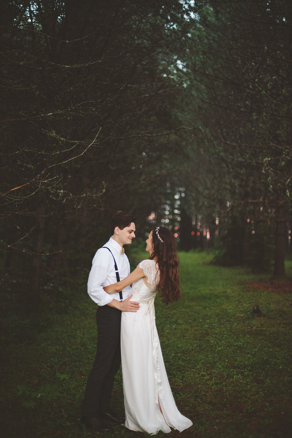 Wedding couple in woods for bridal portraits