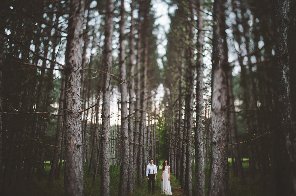 Bride and groom in the deep northern woods