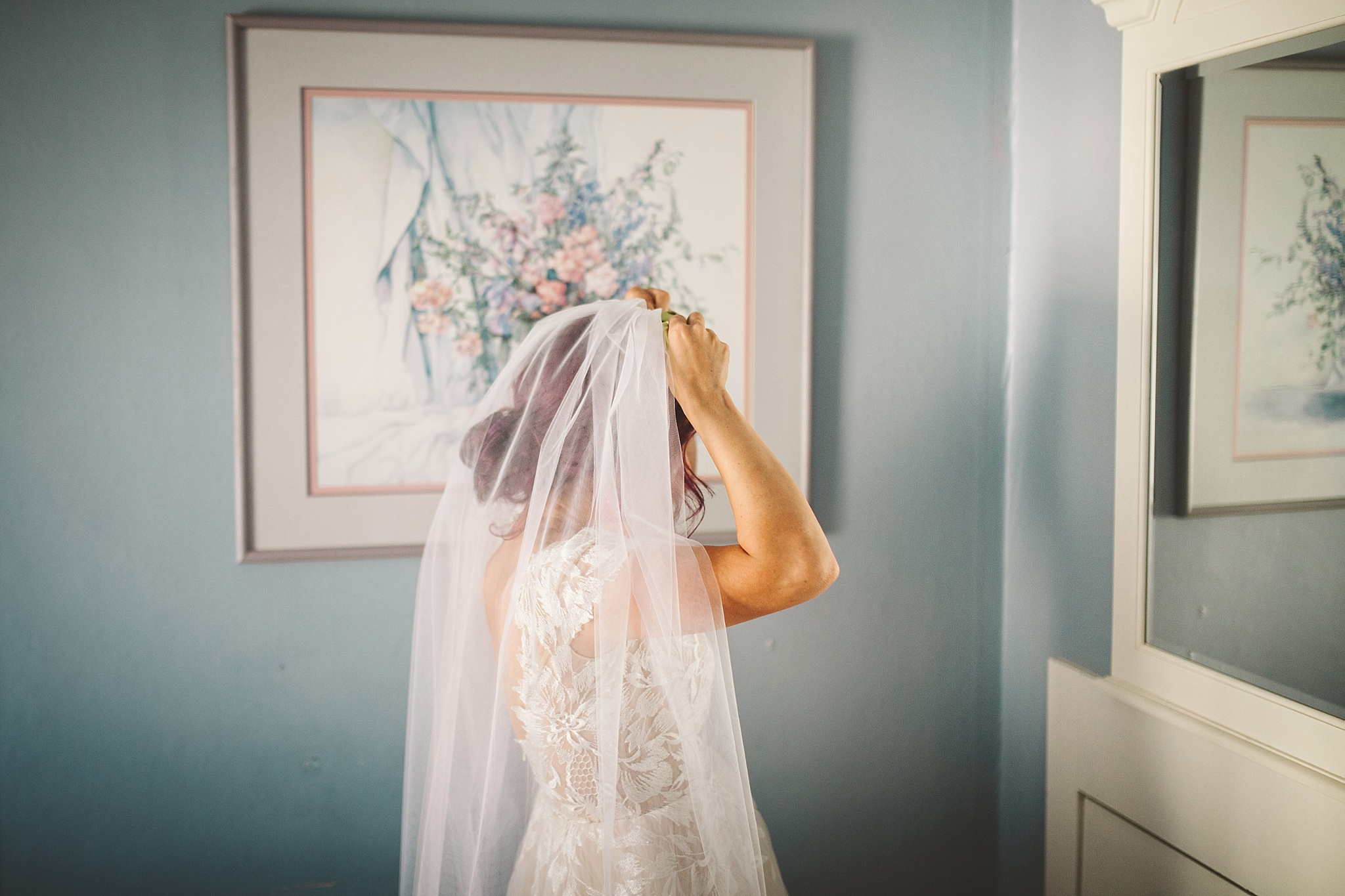 bride puts on her veil mountain wedding