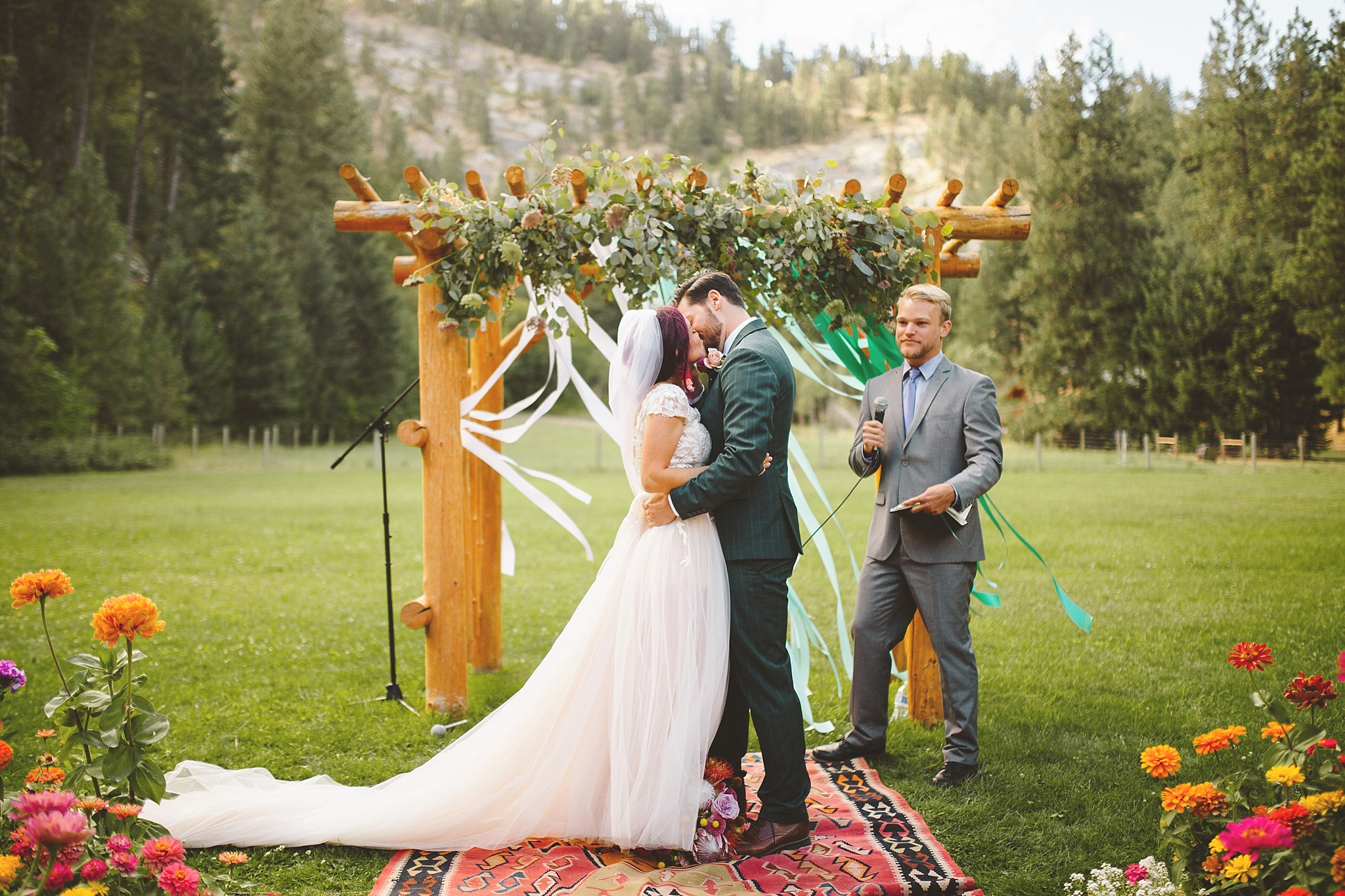first kiss at wedding in woods of washington