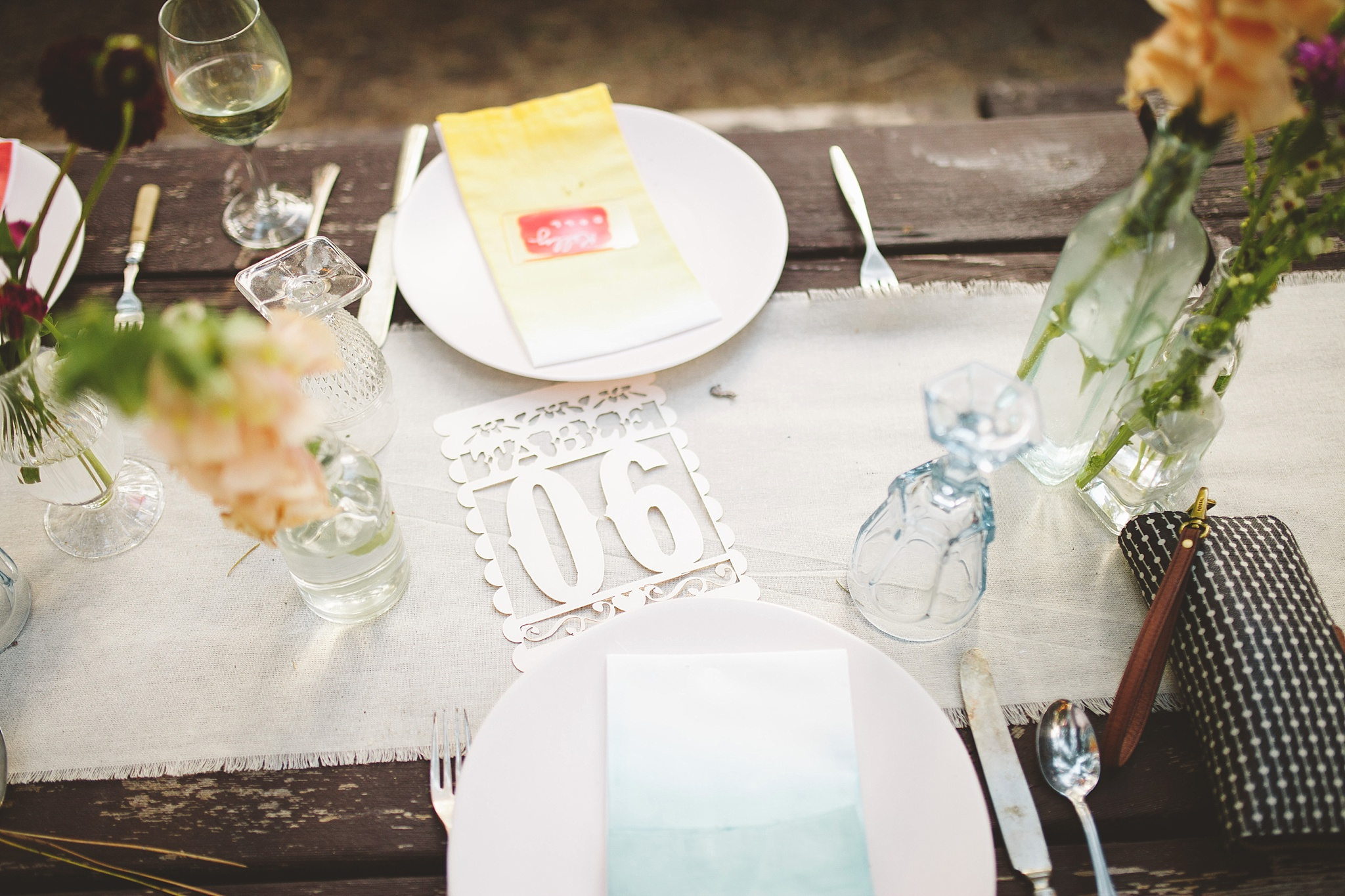 colorful place settings for woods wedding