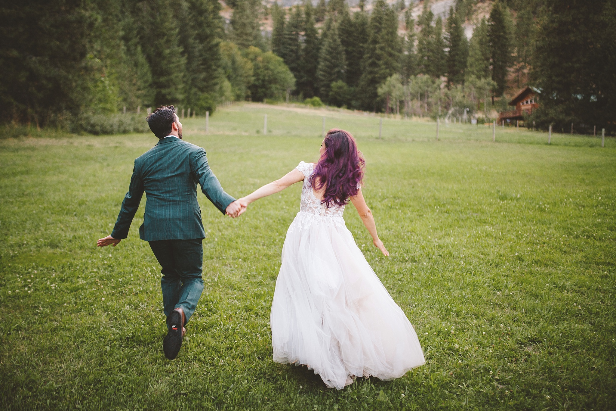 bride and groom skipping together