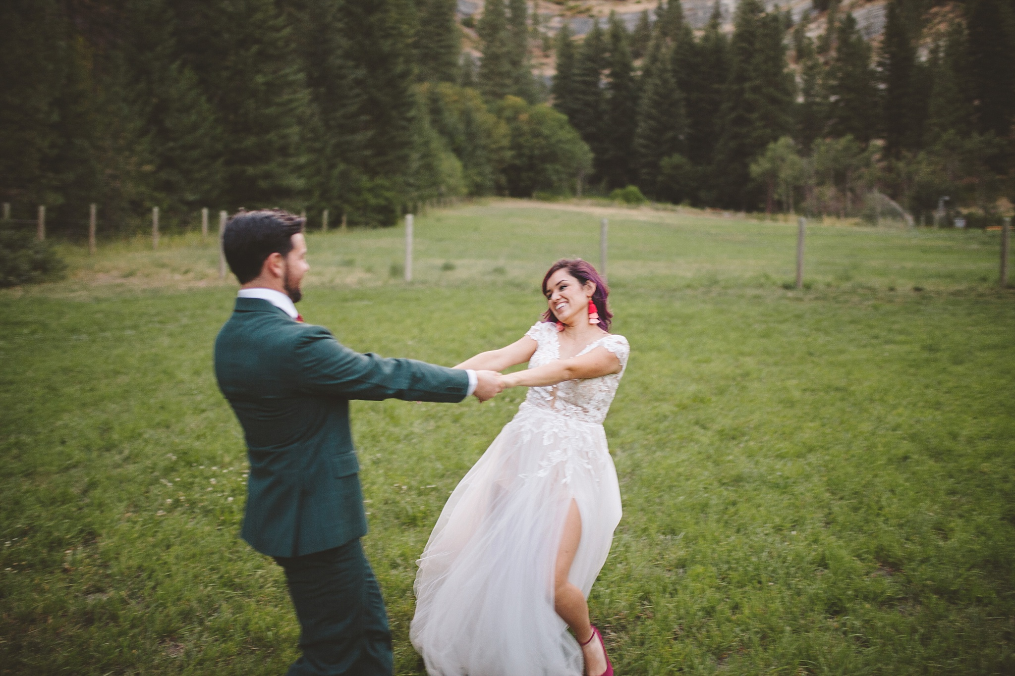 bride and groom dance in the woods
