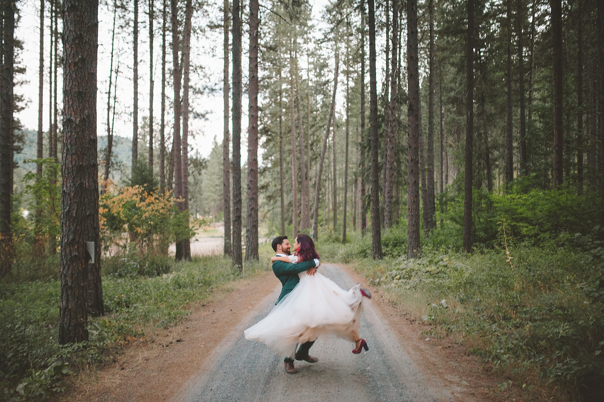 bride twirling in woods pnw wedding