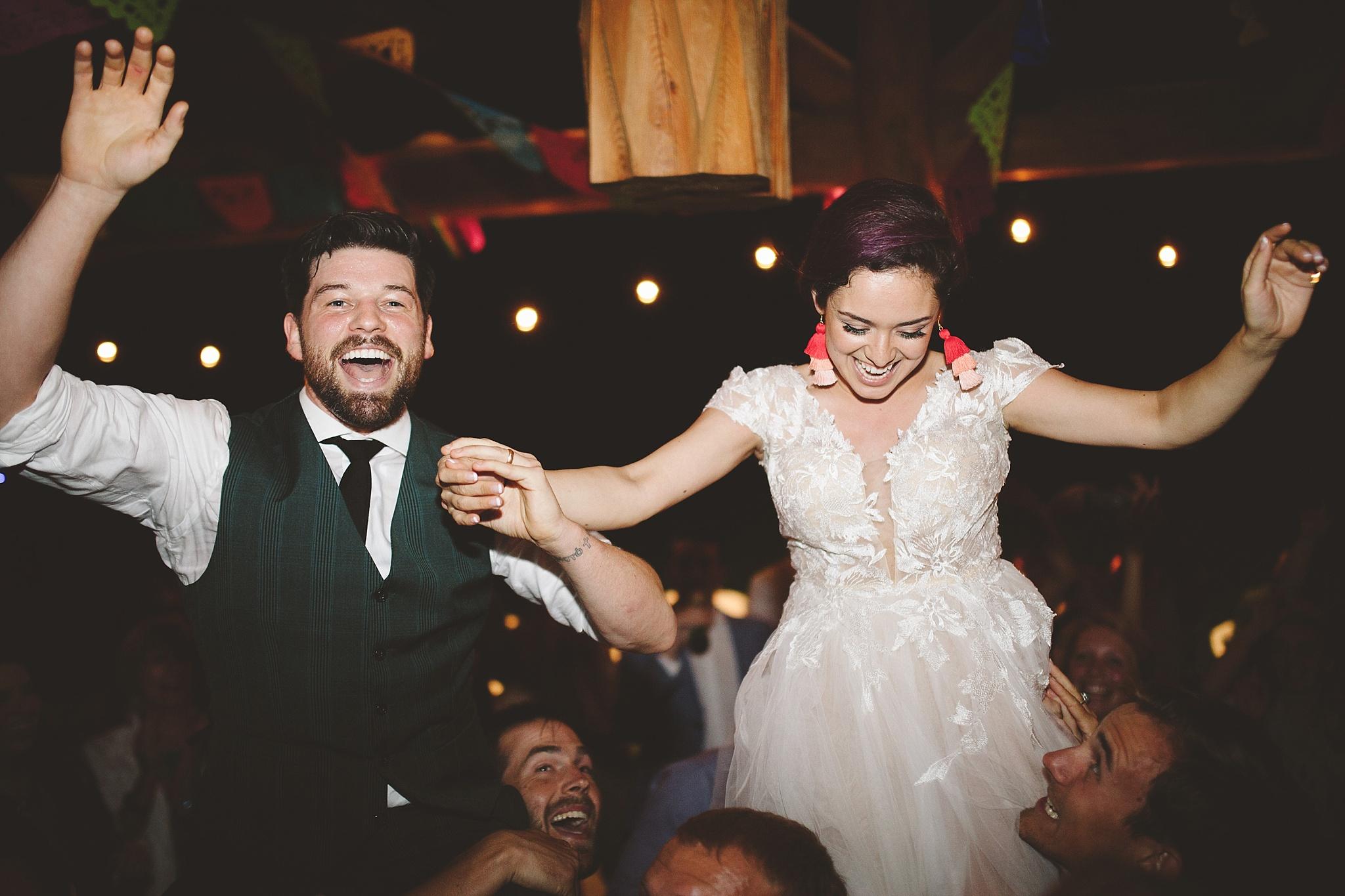 up on shoulders during wedding dance