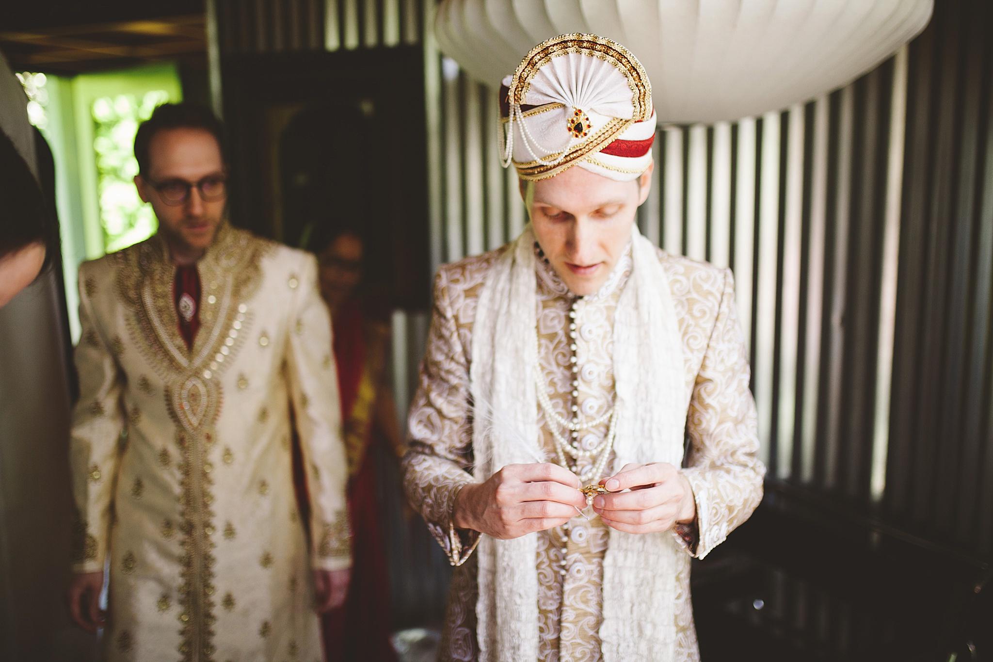 groom getting ready for traditional hindu wedding